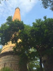 The smoke stack from the sugar refinery.